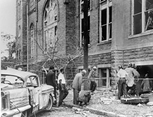 Fire personnel and onlookers view the damage at 16th Street Baptist Church.