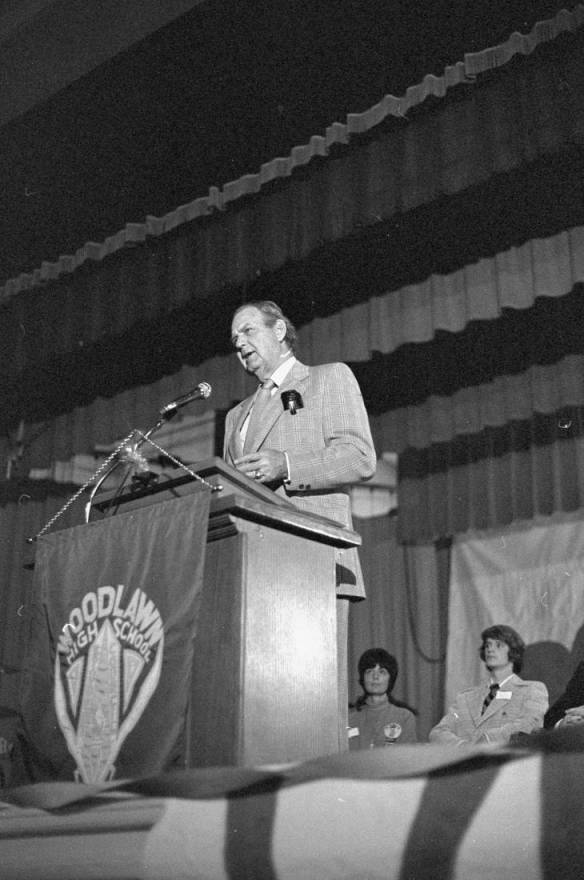 Coach Bear Bryant speaks at Woodlawn High School in 1975